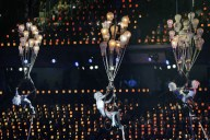 Performers dangle high above the crowd
