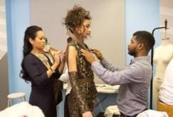 Shan Keith Oliver and his model getting and assist from his mentor, Anya