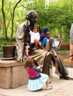 Statue of Hans Christian Anderson (1805-1875), appropriately crawling with children