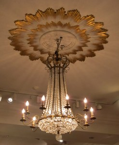 Beautiful crystal chandeliers provide light all over the store