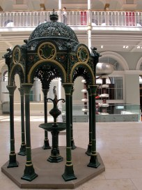 The Grand Gallery houses this amazing wrought iron drinking fountain. The thing in the background that looks like came from a science fiction movie set is the Cockcroft-Walton generator.