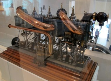Ooh, shiny! This is a model of a steam engine used in 1900 on a torpedo destroyer.