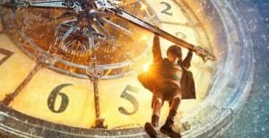 Hugo hanging from clock